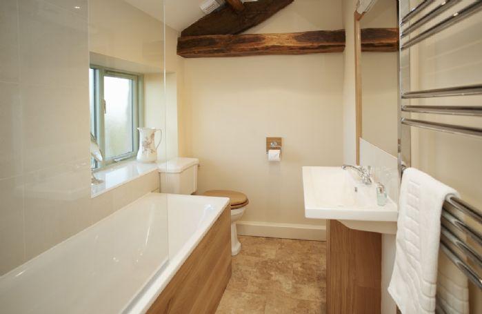 First floor: En-suite bathroom with handheld shower attachment belonging to Bedroom 3