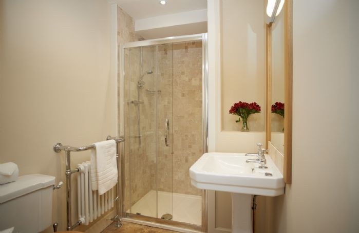 First floor: En-suite belonging to Bedroom 1