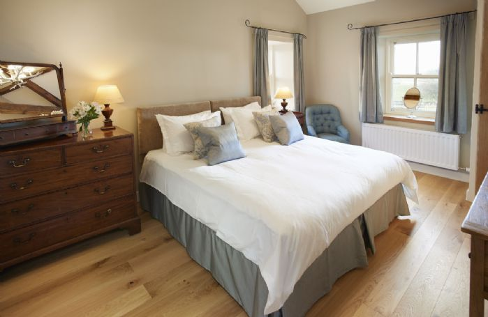 First floor: Bedroom 1 with 6' zip and link double bed and en-suite shower room