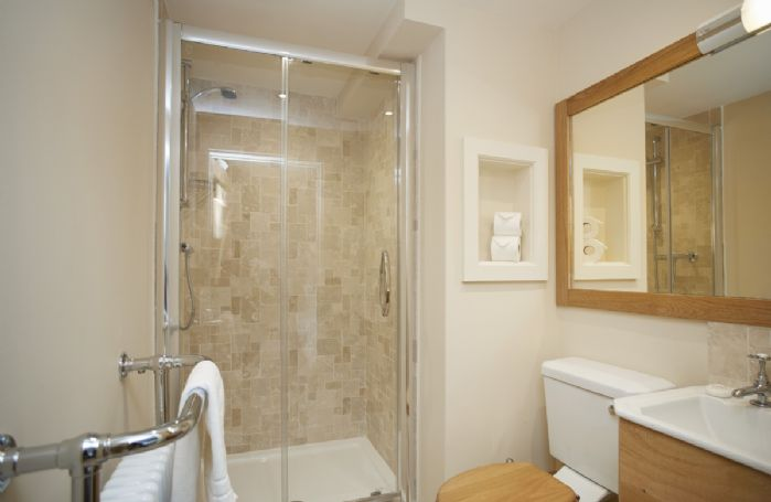 Ground floor: En-suite shower room belonging to Bedroom 6