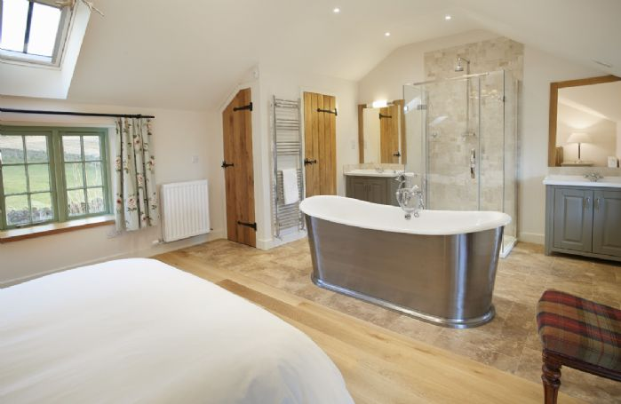 First floor: Free standing cast iron bath, shower cubicle and separate wc in Bedroom 4