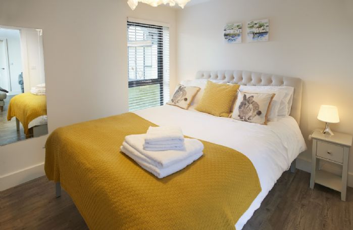Ground floor: Spacious double bedroom with king size bed