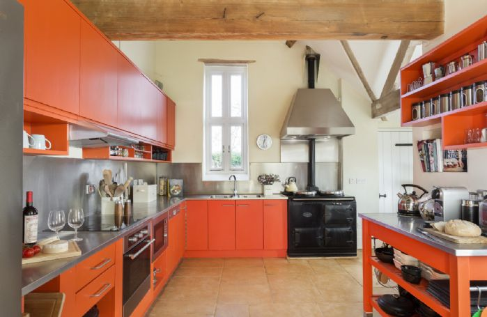 Ground floor: Kitchen with large well-equipped cooking area and AGA