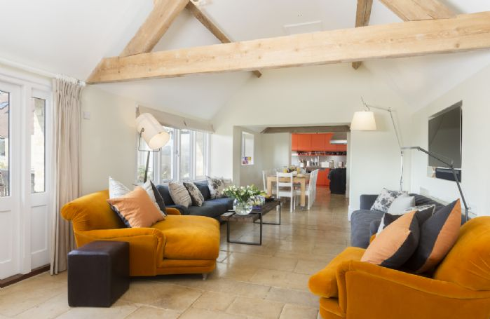 Ground floor: Open plan living area with kitchen, dining area and sitting area, with French windows leading to the courtyard garden