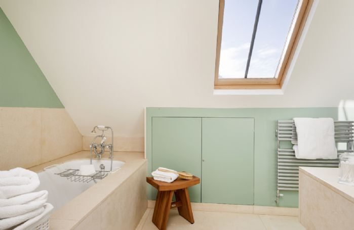 First floor: En-suite with bath and handheld shower attachment