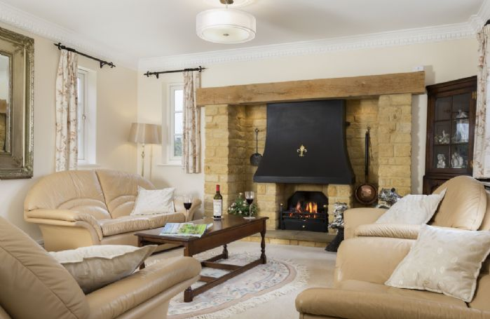 Ground floor: Comfortable sitting room with feature fireplace