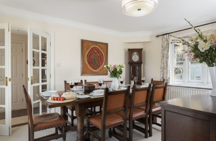 Ground floor: The elegant dining table with seating for eight guests