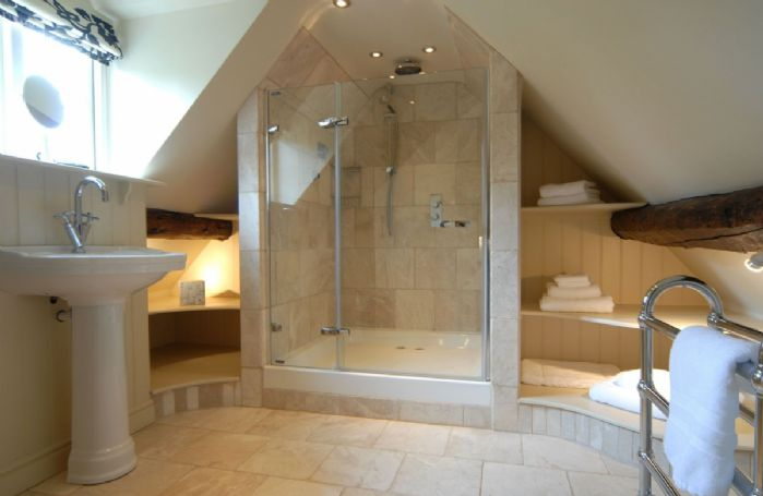First floor:  En-suite shower room with double drench shower