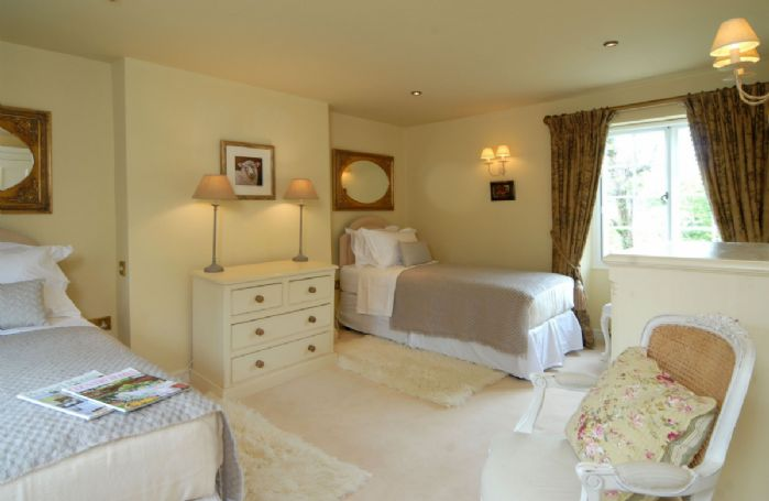 First floor:  Double bedroom with 6' zip and link bed, shown here as singles