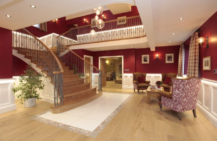 Ground floor: Grand hall with stunning curved oak staircase with elegant staircase
