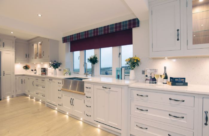 Ground floor: The luxuriously modern and fully equipped kitchen with two american style fridge freezers and four ovens