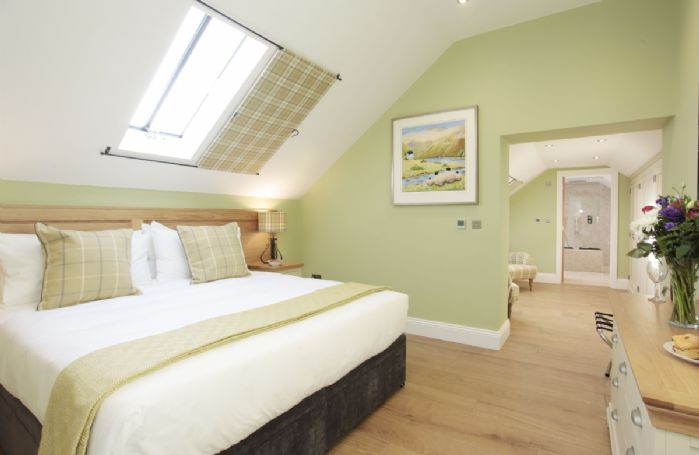First floor: Double bedroom with 6' zip and link bed and walk through wardrobe are
