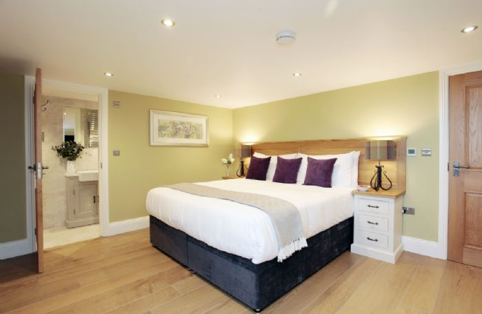 Third floor: Double bedroom with 6' zip and link bed and ensuite