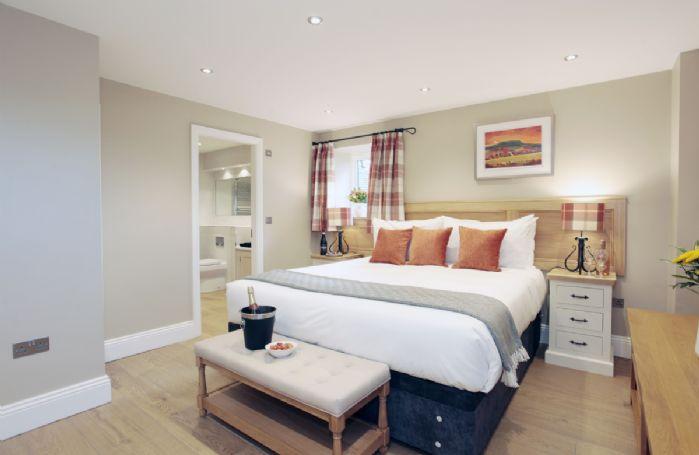 Second floor: Double bedroom with 6' zip and link bed and en suite
