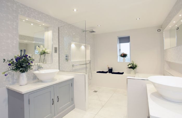 Ground floor: Ensuite with walk in shower with seat, separate bath and two sinks
