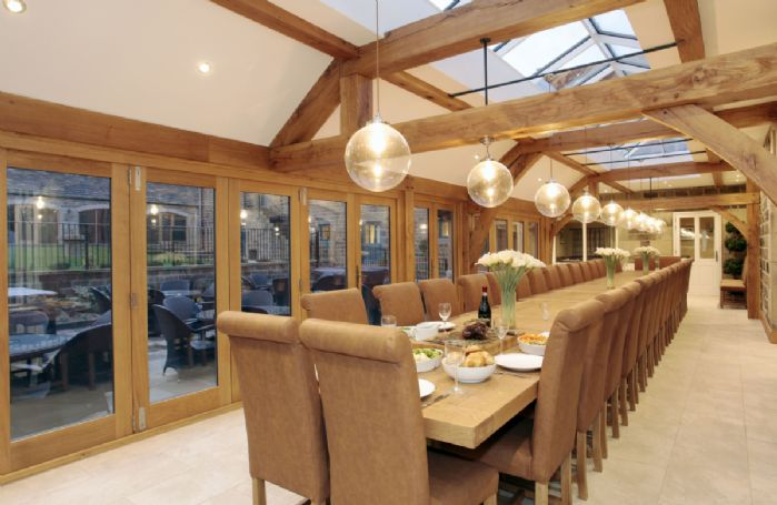 Ground floor: Orangery with oak dining table will comfortably seat 36 guests and bi fold doors leading out to the patio