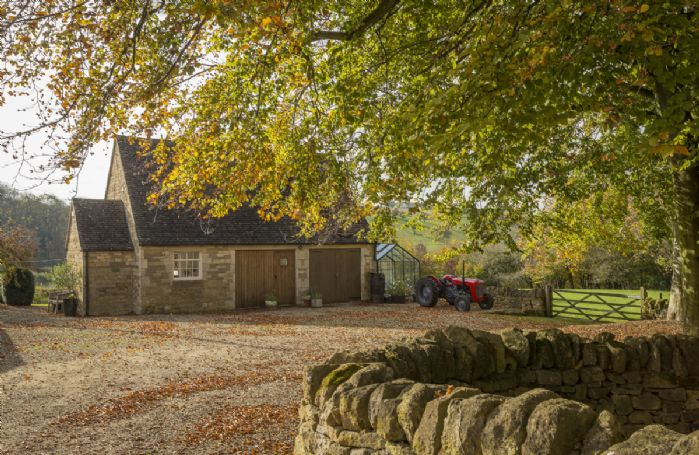 Converted from Cotswold stone outbuildings, Tally Ho Cottage is a romantic bolthole tucked away in a hidden valley