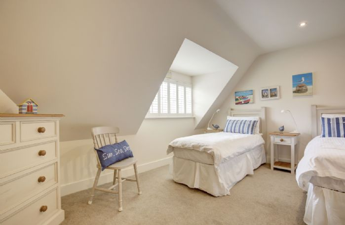 First floor: Bedroom four (The Beach room) with a 5' zip and link king size bed