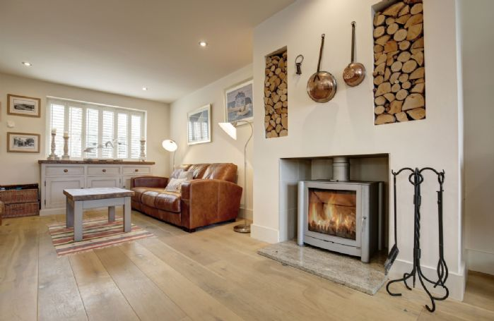 Ground floor: Sitting area with 'Firebelly' multi-burner