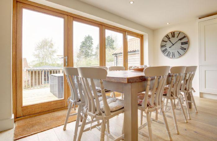 Ground floor: Dining area with bi-fold doors to the outdoor deck