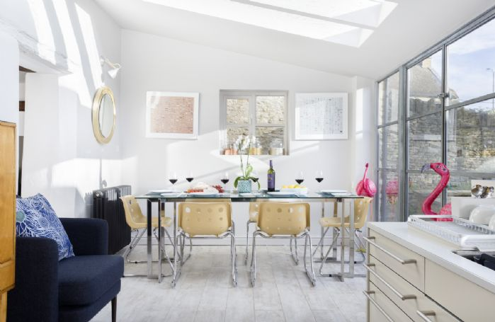Ground floor:  Open plan sitting room extends to dining area