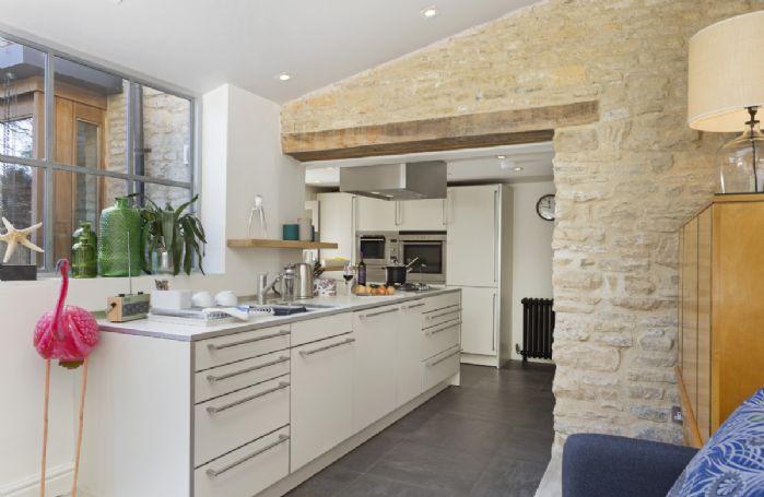 Ground floor: Open plan modern fitted kitchen
