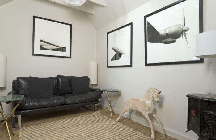 Ground floor:  Snug with sofa and comfy floor cushions