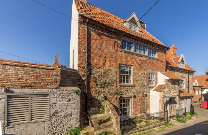 St Michael's Cottage is a 16th Century flint and brick built former merchant's house set over four floors