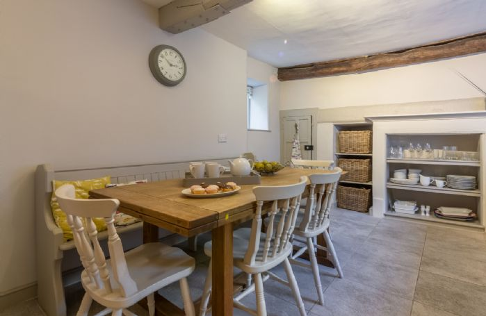 Ground floor: Kitchen/diner with underfloor heating and extendable dining table with pew and chairs to seat 10