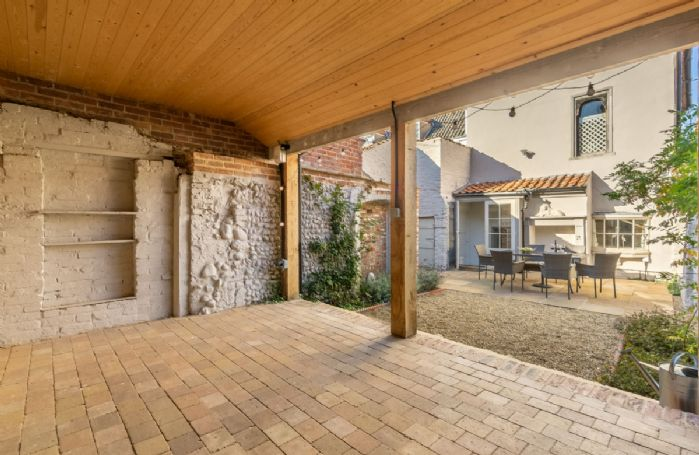 Sunny south facing enclosed paved courtyard