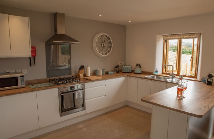 Lower ground floor: Open plan fully fitted kitchen with views