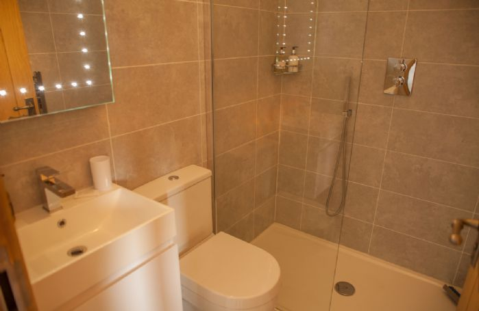 First floor: En suite with bath and separate shower