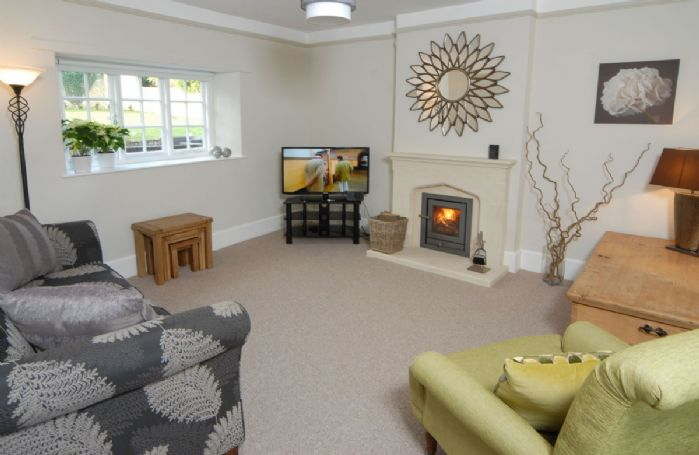 Ground floor: Television room with comfortable seating