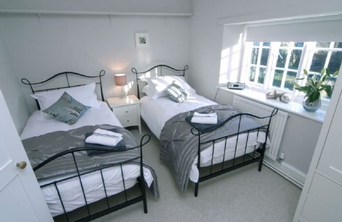 First floor: Twin beds, an ipod dock and views across the garden