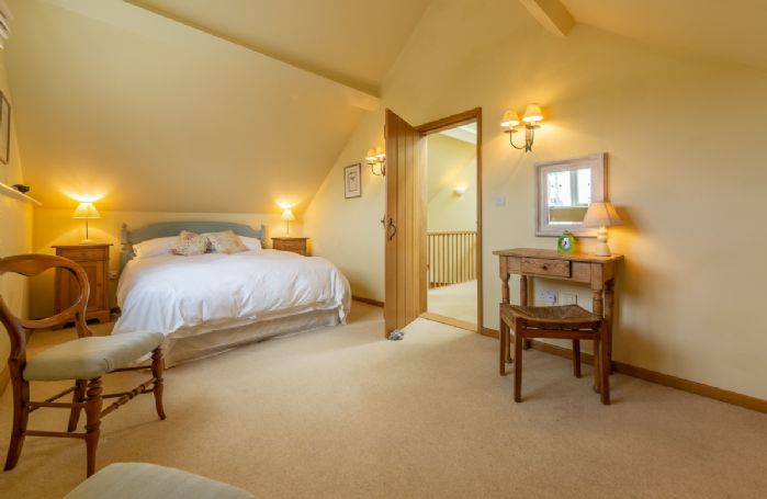 First floor: Master bedroom with king size bed and fabulous countryside views