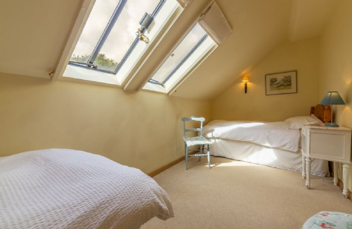 First floor: Double bedroom with two full sized comfortable single beds