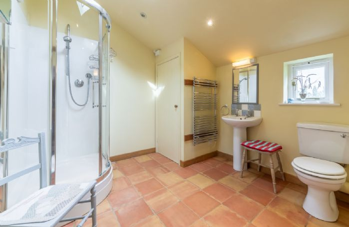Ground floor: Large cubicle shower and heated towel rail