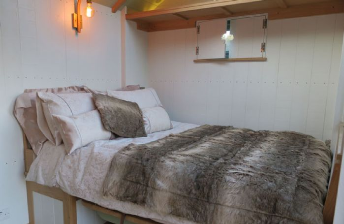 The cosy double bed with stargazing glass panel roof