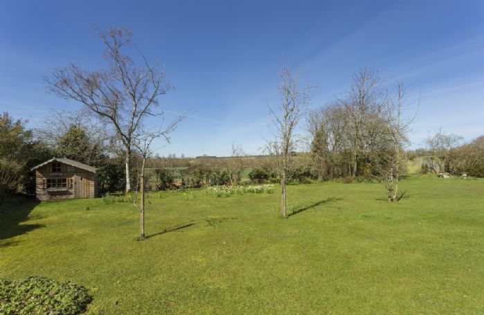 Lowfields enjoys a large garden with half an acre of land