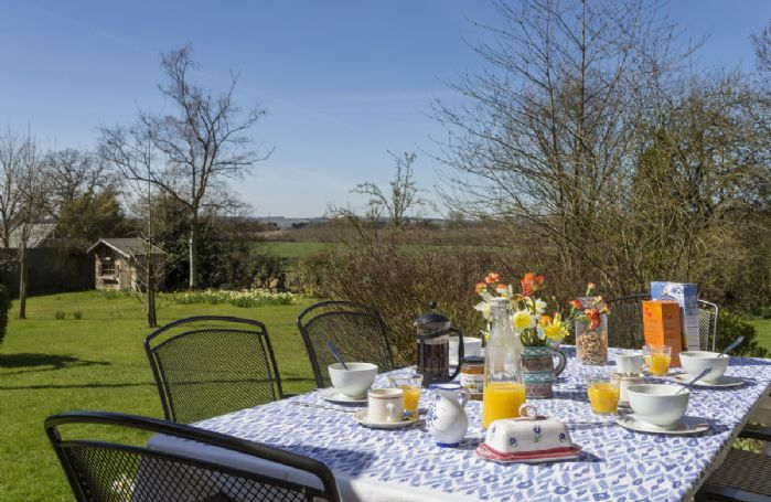 Enjoy dining al fresco on a sunny day with breathtaking country views