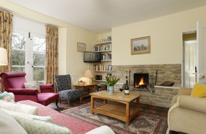 Ground floor: The spacious sitting room with open fire as a central feature