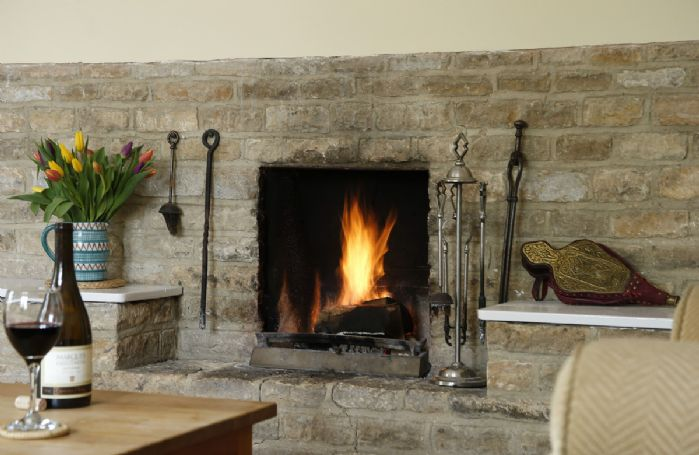 Enjoy a warming open fire on a chilly evening at Lowfields