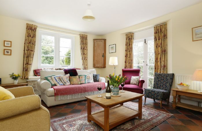 Ground floor: Double aspect windows and cosy sofa to relax in