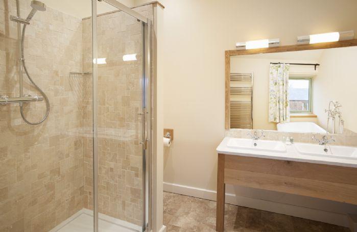 First floor: Master bedroom en-suite with cast iron free standing bath, separate shower and double sinks
