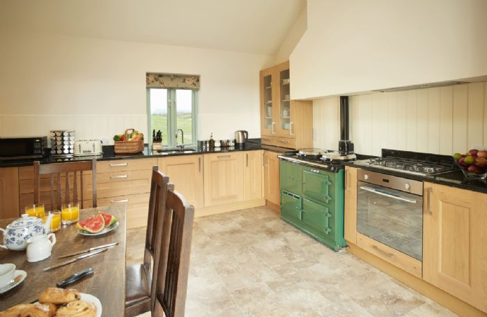Ground floor: The fully equipped kitchen with double Aga