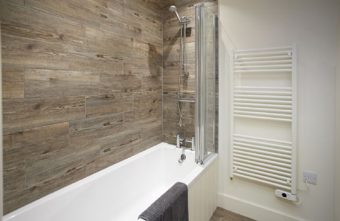 Ground floor: Family bathroom with bath and shower over