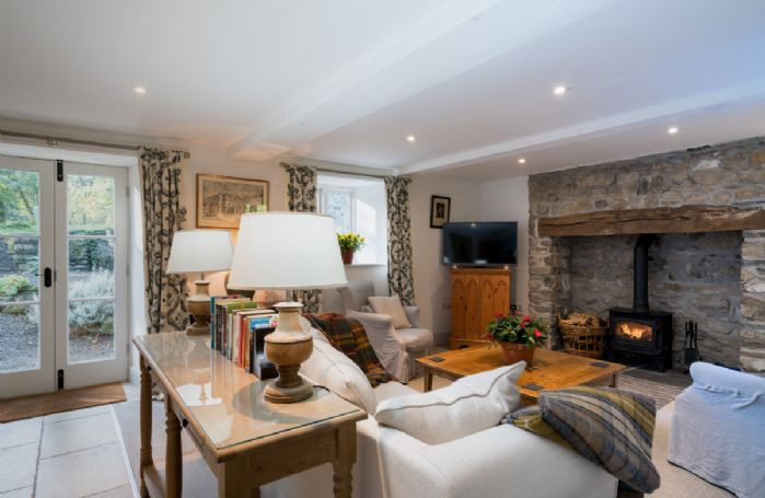 Ground floor: Large sitting room with beamed fireplace using oak from the Estate woods
