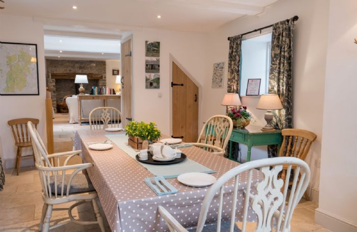 Ground floor: Well appointed dining room with table seating four guests