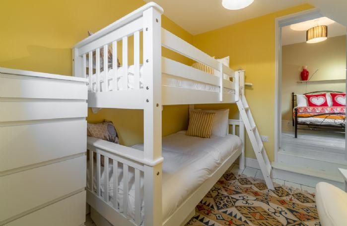First floor: Two steps down from bedroom two is the children's bedroom with bunk beds