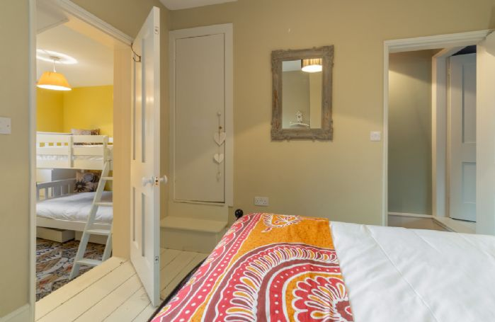 First floor: Bedroom two with door leading to bedroom three